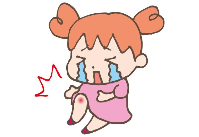 膝をすりむいて泣いている女の子のイラスト